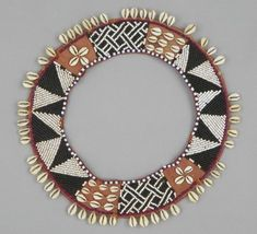 Neck Ornament Place Made:Africa: East Africa, Kenya Period:Mid 20th century Date:1950 - 1970 Dimensions:32 cm Dia. Materials:Cotton; gl...