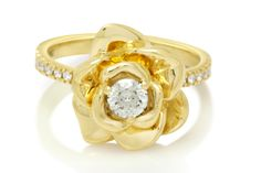 Diamond Engagement Designer Flower Ring 0.27ct 18K Gold, Total 0.35ct  Ring specification:  Metal type: Gold Metal purity: 18k  Metal Weight: 6.5gram          Center Stone  Shape: Round Cut Carat Weight: 0.27ct Color: G Clarity: VS2          Side Stones Shape: Round Cut Carat Weight: 0.8ct Total Color: G Clarity: VS