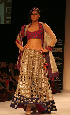 Love the colour contrast & the heavy mirror work on that skirt- Payal singhal!