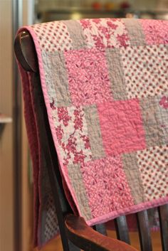 Simple quilt made with 6 inch squares and 6 x 2 inch strips - very pretty