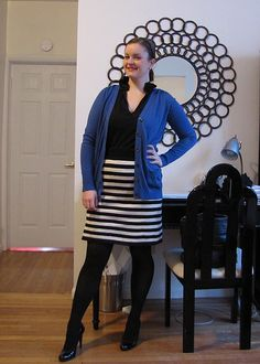 Blue cardigan with black and white stripe skirt, black opaque tights