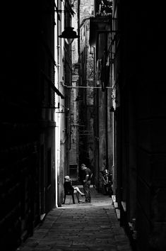 At the dark end of the street. That's where we always meet. Hiding in shadows where we don't belong. Living in darkness to hide our wrong.