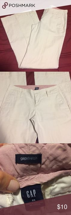 """Gap Trousers Light beige, size 2 regular trousers. Pants have flared bottom with opening measuring 10.5"""" flat.  Worn but still have a lot of life left! Super comfortable and perfect for work. Flat waist measures approximately 15"""" and rise measures 7.5"""". All pockets functional and back 2 pockets have buttons. GAP Pants Trousers"""