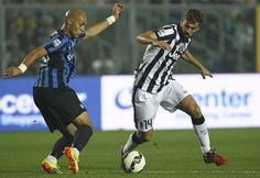 Fernando Llorente (R) of Juventus FC is challenged by Yohan Benalouane (L) of Atalanta BC during the Serie A match between Atalanta BC v Juventus FC at Stadio Atleti Azzurri d'Italia on September 27, 2014 in Bergamo, Italy.