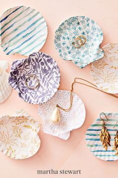 Transform a scallop shell into a keepsake anyone is shore to love. Cut out a circle of scrapbook paper that's an inch bigger than your shell all around, then brush the back of the paper with découpage glue and press it on, starting at the center, and smoothing out any air bubbles. #marthastewart #crafts #diyideas #easycrafts #tutorials #hobby