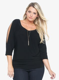 Flirty open sleeves show peeks of skin on this draping black knit top. plus fashion We've added elastic gathering on the side seams of the flattering banded bottom.