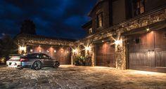 Luxury garage remodel using VAULT garage cabinets, garage flooring, carriage-style garage doors, garage lighting and custom neon signs.  #garages #garage #luxurygarage #lux #neon #luxurycars   http://www.vaultgarage.com