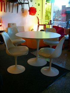 Eero Saarinen Tulip Table + Chairs - love how the white gloss is a great base for the light coming from the stained glass