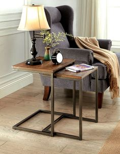 "2 pc Zia collection medium weathered oak finish wood and metal frame nesting table set . Measures 18"" x 15"" x 22"" H. Smaller table measures 16"" x 13 1/4"" x 20 1/2"". Some assembly required."