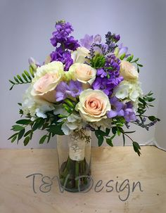 Absolutely stunning bridal bouquet with lavender freesia and blush roses.
