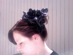 I like this idea of wearing a corsage thing further back on the head