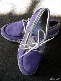 A pair of purple suede shoes.