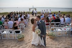 harbor lights resort wedding photo on beach in Frankfort Michigan with design and flowers by Simply Exquisite by the Bay and photo by Paul Retherford #frankfortwedding #beachwedding #puremichigan #lakemichiganwedding #weddingvenue #destinationwedding #northernmichiganwedding #nomiweddings #weddinglocation #beachwedding #love #forever #nomatterwhat #Bride #Groom