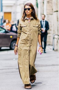 Viviana Volpicella wears a maxi shirtdress, furry slide sandals, a statement necklace, and Ray-Ban sunglasses