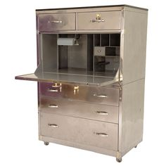 Industrial Polished Steel Secretary Desk | From a unique collection of antique and modern secretaires at http://www.1stdibs.com/furniture/storage-case-pieces/secretaires/