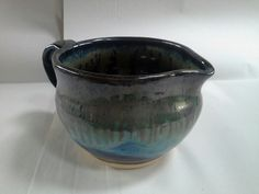 Amaco potters choice glazes.   Obsidian x 2, seaweed x 2, rim of Ancient Jasper.   Beautiful