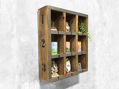 Display your favourite vintage collectables or spices in this hanging pigeon hole shelving unit. Turn that bare wall into an eye catching display. View online