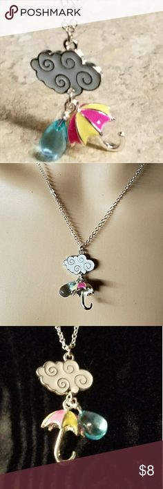 "Rainy Day Necklace ""The Weather Girl"" Don't let a rainy day cramp your style. This super adorable necklace has a silver 3D umbrella charm with yellow & pink stripes, a crystal blue raindrop, and a white enameled silver cloud. Also makes a great gift for the weather girl in your life! Silver lobster clasp closure.  Measurement coming. If trying to purchase prior to being done, please send me a message. Item#N1306 👀 See Sale Alert for Current Sale 🛍 25% OFF BUNDLES OF 3 ✔REASONABLE OFFERS…"