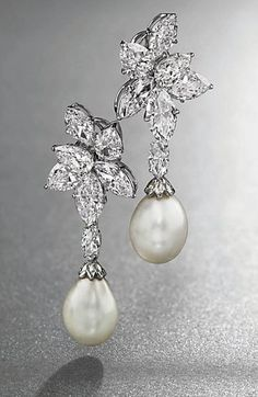 A PAIR OF DIAMOND EAR CLIPS, BY HARRY WINSTON, WITH NATURAL PEARL PENDANTS