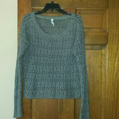 Grey sweater Super cyte grey acrylic/polyester cable knit sweater. Has silver threading throughout. Great for the holidays! Lightweight. Bought from another posher byt its too short on me. 24 1/2 in long. It is a generous medium and will fit a large Aeropostale Sweaters Crew & Scoop Necks