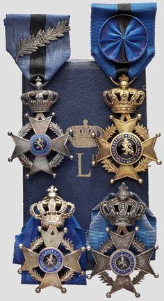 Order of Leopold II set of 4; 3 Knight's breast badges; Type 2, 1908-1951 unilingual (French); one with silver 'A' palm on ribbon; 1 Officer's breast badge; Type 3, 1951 bilingual, (French & Dutch) obv