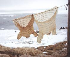 Gut parkas hang in the breeze at Mekoryak, 1964 by Steve McCutcheon