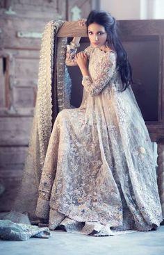 Excellent usage of lace in this rich bridal lehenga.  #desi #bridals #outfit #ootd #lace #motifs #detail #cream #lehenga #bridal #weddings