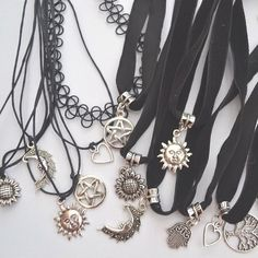 Image via We Heart It https://weheartit.com/entry/149179706 #accesories #black #dark #earth #flower #grunge #heart #indie #lovely #moon #pale #sun #grungestyle #softglow #glow. #softpale #tattochoker