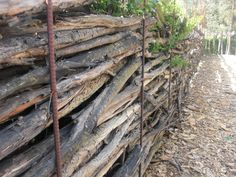 woven wood fence - note rusted rebar!