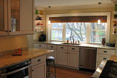 kitchen sink & stove on same wall with windows pictures   And here is a view…