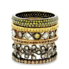 18k gold and black rhodium bands with: (from top) 0.65 ct. t.w. green diamonds, $ 1,550, 0.50 ct. t.w. yellow diamonds, $ 1,350, 0.96 ct. t.w. multicolored diamonds, $ 2,600, 0.50 ct. t.w. burnt orange diamonds, $ 1,300, 0.64 ct. t.w. white and burnt-orange diamonds, $ 2,200, 0.70 ct. t.w. champagne diamonds, $ 1,250; Sethi Couture at Fragments, New York City; fragments.com