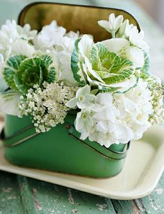 Green and white...fantastic use of color, texture and the old lunch box...Kudos to the designer!