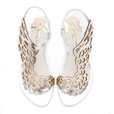 Stunning silver metallic leather sandal embellished with a rose gold Angel wing. Perfect for any occasion.