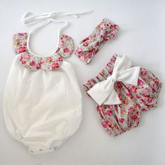 So cute for baby! 3 Piece outfit perfect for the warmer months! 3 pieces include - one piece romper, shorts, headband One piece has tie neck, buttons at legs, print detail around neck Matching shorts