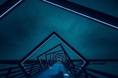Would you believe us if we told you this mesmerizing work of art is actually a bridge stretching long across rural Iowa? It is High Trestle Trail Bridge located Madrid Iowa captured brilliantly by photographer Tony Webster Neon Light Wallpaper, Lit Wallpaper, Black Wallpaper, Adhesive Wallpaper, Wallpaper Wallpapers, John Pawson, Science Fiction, Mountain Photos, Architecture