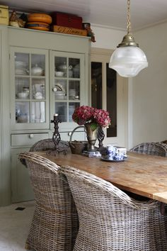 Farm table and wicker chairs