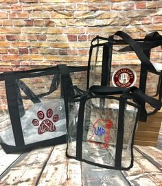 Game day just got a little better with our Monogrammed Clear Stadium Tote Bags! Both Style bags are sized to meet new requirements for tote bags put in place by the NFL, SEC and many other colleges and universities for sporting events. Personalize yours with your choice of monogram style and vinyl color to show your team spirit. Small clear tote bags measures 12 x 6 x 12 and meet NFL and SEC size requirements as well as most colleges/universities. Each tote is made of 100% durable clear PVC…