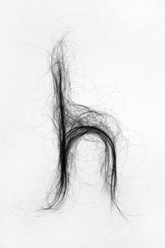 Дизайнер создала шрифт из человеческих волос. Изображение №1.