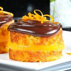 Posh Jaffa Cakes- homemade clementine jelly sandwiched between moist flourless orange-almond sponge, slathered in chocolate ganache.