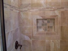 I like the 3 different tiles used here to accent a stripe and the inside of the niche.