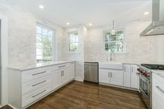 Do you need upper cabinets in a kitchen? Look how clean and fun it looks without!  #nouppers #Whitekitchen #sanMarco #renovatedKitchen