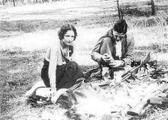 Bonnie & Clyde cleaning guns in the woods.It was no easy life.Showering and bathing in streams and cold water.Especially after they became famous in the papers even getting food was hard.Bonnie was also wounded at different times and sometimes very badly.Once she got 3rd degree burns to her legs when Clyde  had wrecked.The burns were so sever sometimes she could barely walk.Clyde would carry her and doctored her burns.It is said these burns almost killed her they were so bad.