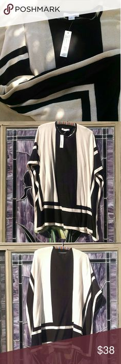 August Silk Black and Cream Square Poncho Top Brand new with tags, August Silk cream poncho cape top featuring a black geometric bar pattern on both sides.   Drapes squarely with a cape-like effect, stitched below the armpit so it wears more like a loose blouse than a poncho. A great statement top that goes great with jeans and a favorite pair of shoes for a classy casual look. august silk Tops