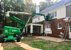large crane lift used to paint the back of a brick house white White Brick Houses, White Exterior Houses, Ranch Exterior, Modern Farmhouse Exterior, House Paint Exterior, Exterior House Colors, Brick Painted White, Painted Brick Exteriors, Colonial House Exteriors
