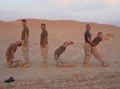 Military guys having fun n the sandbox.. lol too funny