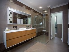 Wood panelling in a bathroom design from an Australian home - Bathroom Photo 7148357