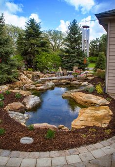 Backyard Water Feature   Enjoy your backyard patio - complete with a fire pit, lush landscaping and the soothing sound of water.