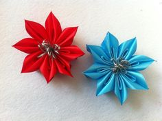 The folding of the ribbon yields a unique pattern inside each petal.  This flowers looks really beautiful in satin. The material really brings out the beauty of this flower.  This flower would make a lovely hair clip.     Materials   	satin ribbon 	scissors 	embellishmens 	needle 	thread