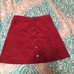 Rust/Burnt orange skirt Material is like cordaroy. Buttons open all the way to the bottom. NWOT Skirts Mini