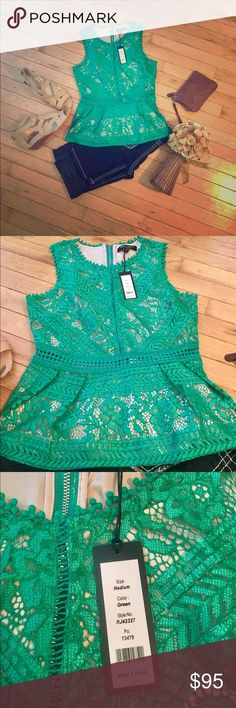 Green lace peplum tank This tank top is absolutely adorable. It has so much detail and spunk. Zips up the back and has see through cut outs towards the bottom and up between the breast. You can dress it up or down. This would fit a s/m best. Romeo & Juliet Couture Tops Tank Tops